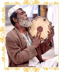Man Playing Drum in Mosque, Ajmer